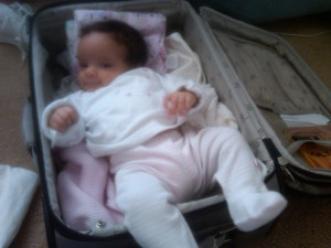 Baby in suitcase